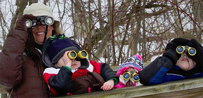 photo of me and 3 grandkids with binoculars
